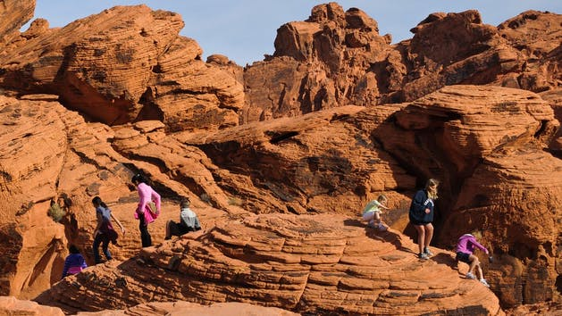 a group of people on a rocky hill