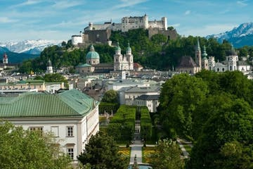 a castle like building with Salzburg in the background