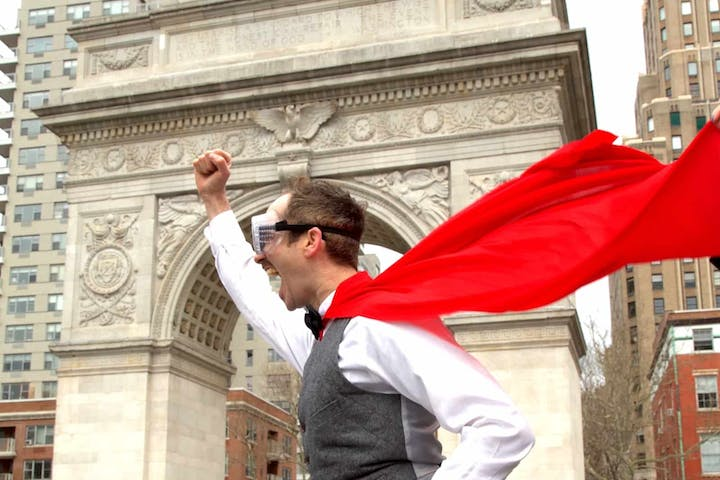 Man dressed as superhero in Washington Square Park