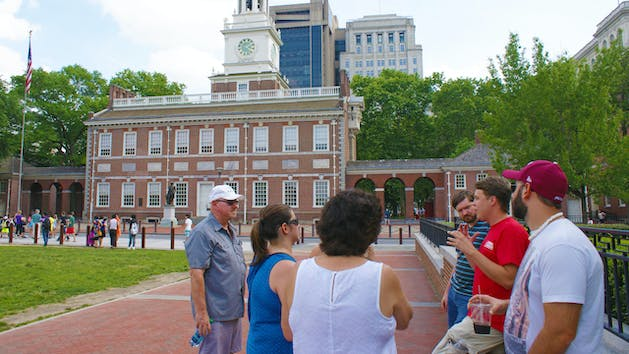 a group of people standing in front of Independence Hall