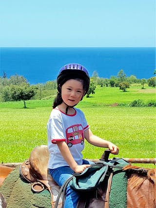 Young girl in saddle