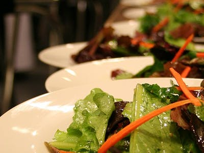 Fresh salads on white plates
