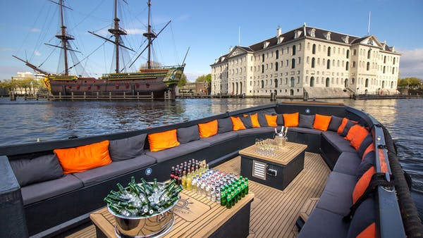 Partygoers enjoy a luxury canal cruise