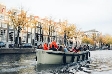 open boat cruise on canal in fall