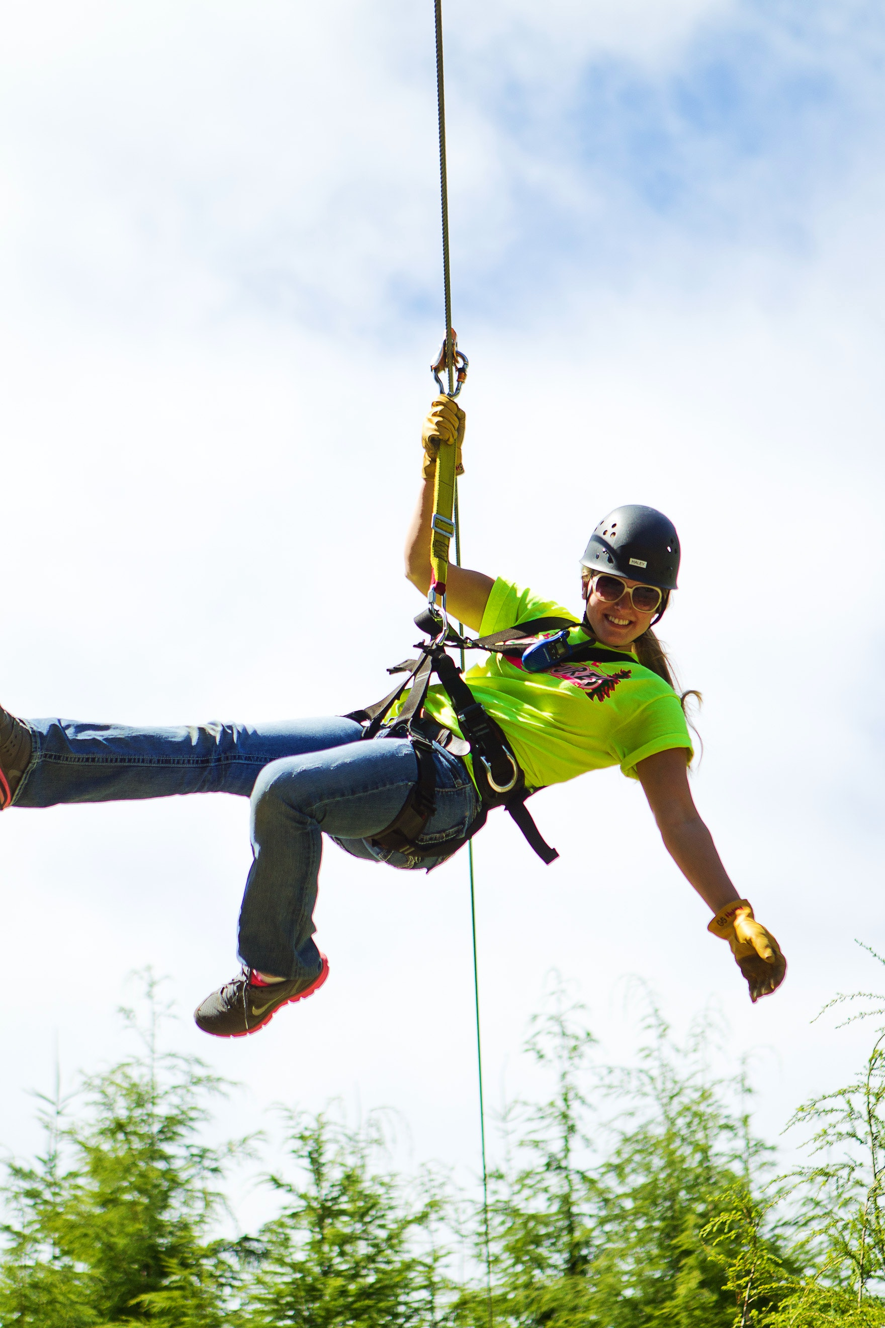 Haley smiles as she zip-lines with High Life Adventures