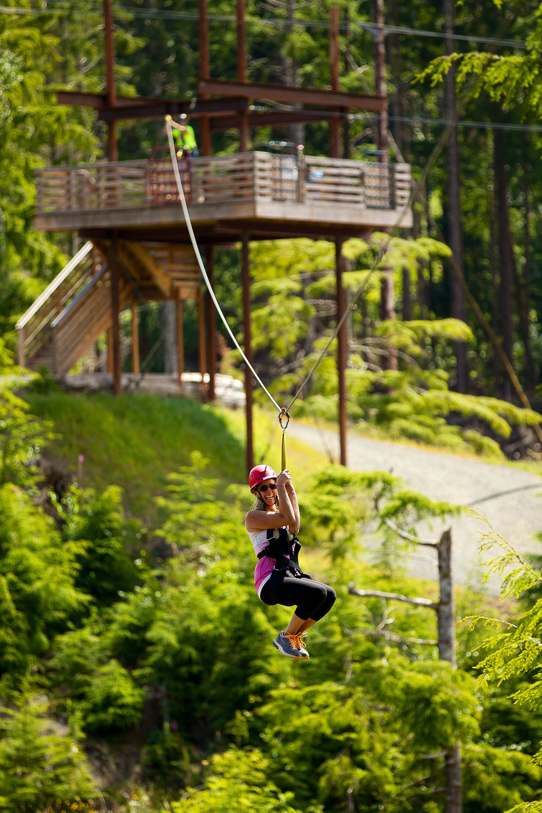 A woman smiles on a High Life Adventures zip line