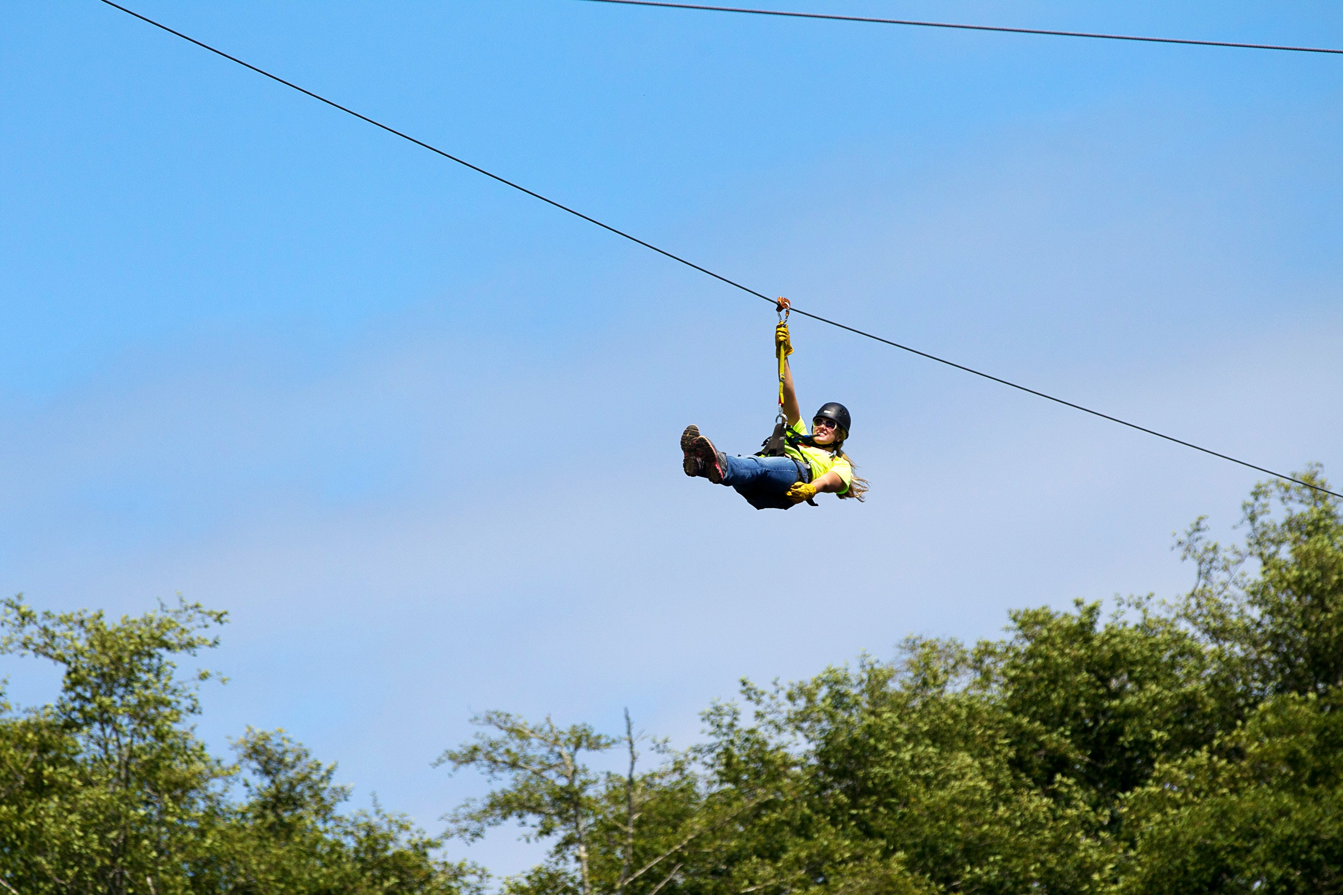 A woman soars on a High Life Adventures zipline