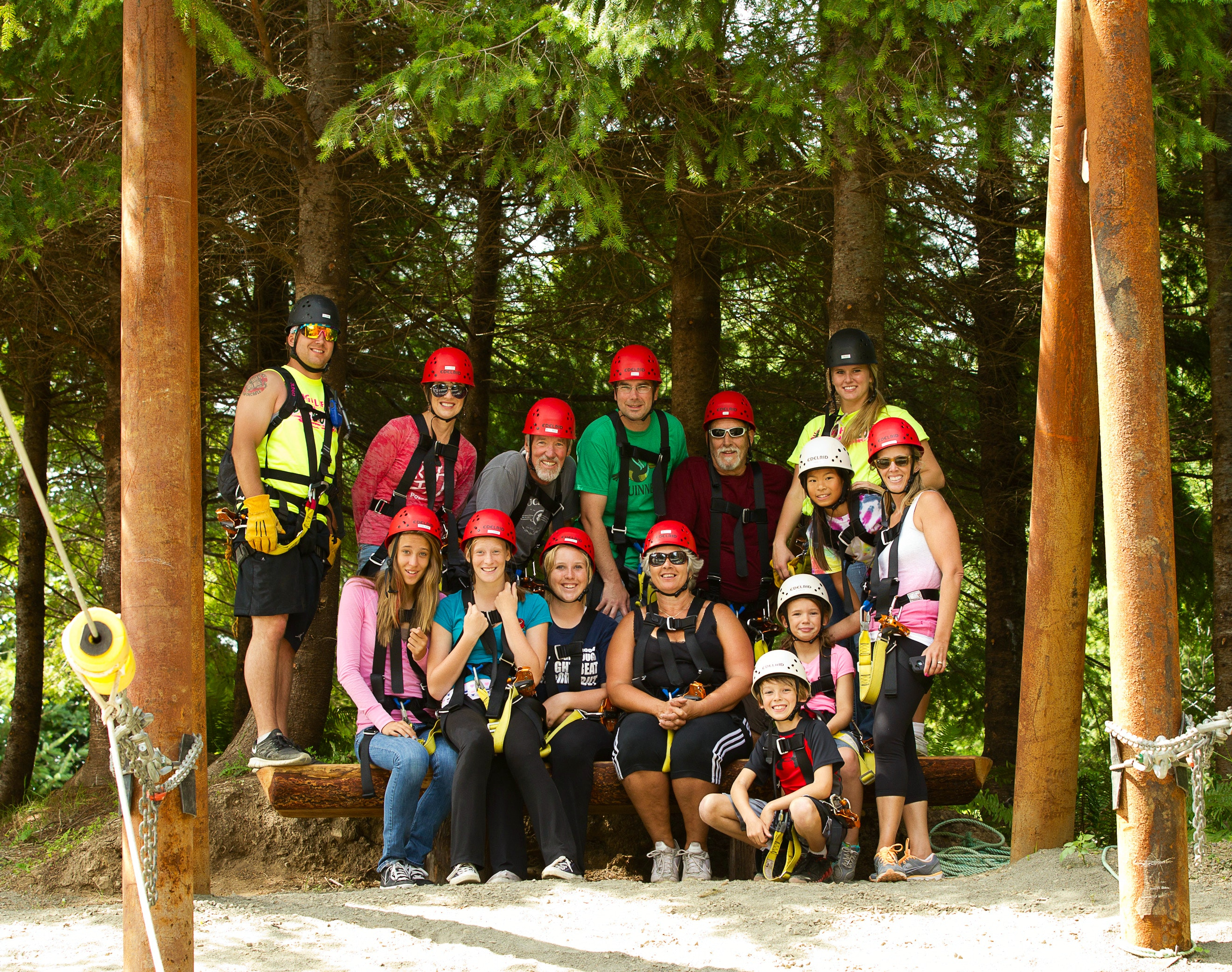 A ziplining group poses for a photo on the course