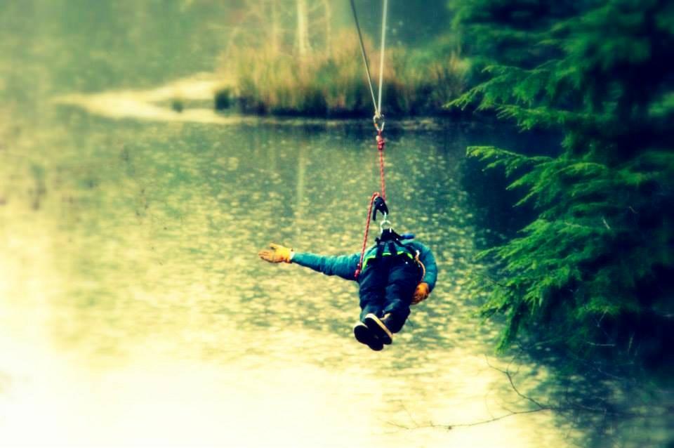 A zipliner relaxes on the High Life Adventures zipline course