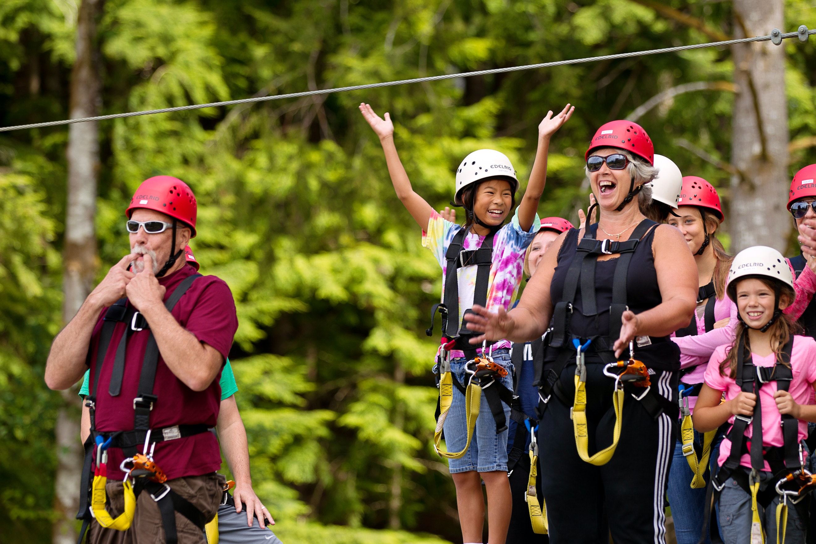 A group cheering on the zip lining course