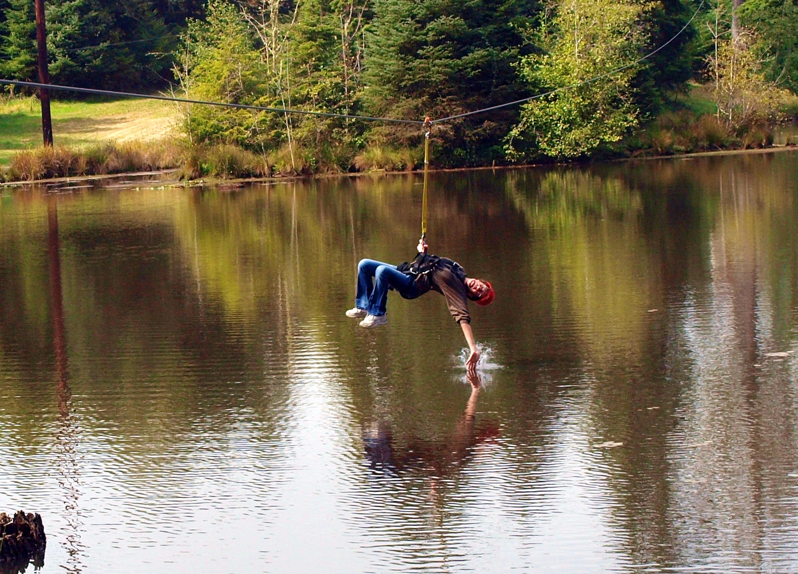 A zipliner touches the lake in Warrenton