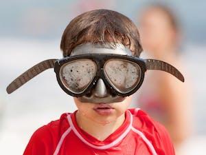 Dive mask lens needing defog before scuba diving.