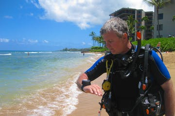 Maui scuba diver reviewing safety skills at the beach.