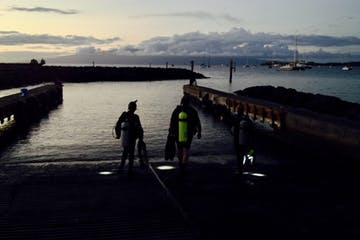 Maui night dive entry for scuba divers at Mala Wharf.
