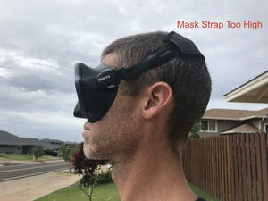 Scuba diving mask strap incorrectly positioned too high on the head.