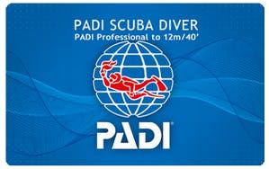 PADI scuba diver card rated to 12 meters or 40 feet with a professional.