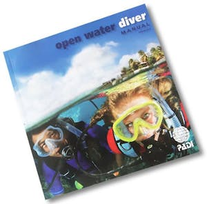 PADI Open Water Manual for a Maui scuba certification course.