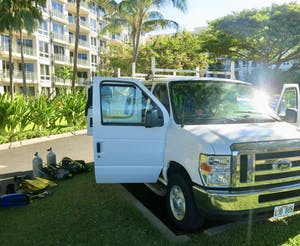 Maui dive shop van ready for scuba diving at Airport Beach.