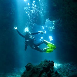 Maui diving with diver inside cavern at First Cathedral on Lanai.