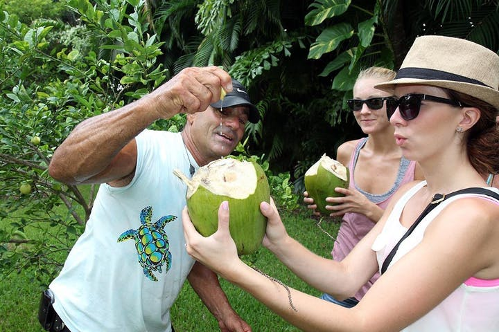 lloyd squeezing lime into a coconut