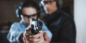 Shooting instructor helping customer