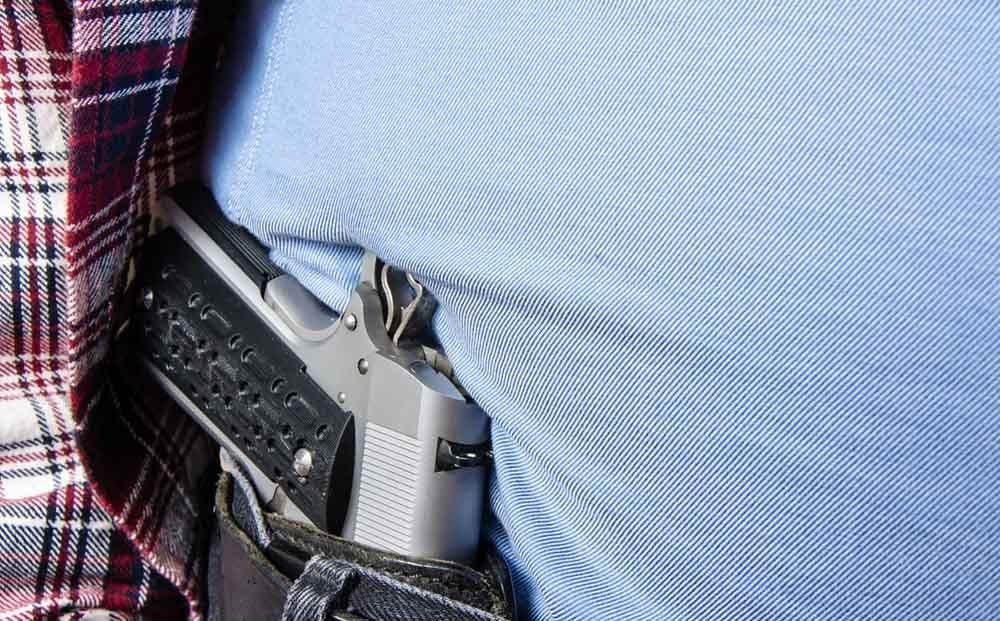 Man concealing gun