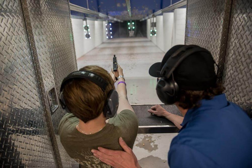 gun instructor showing someone how to shoot