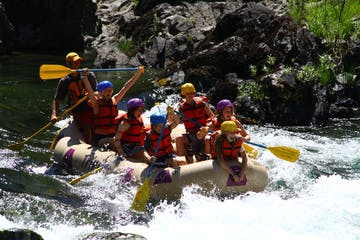 Having fun while white water rafting on the Trinity