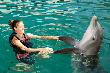woman dancing with dolphin