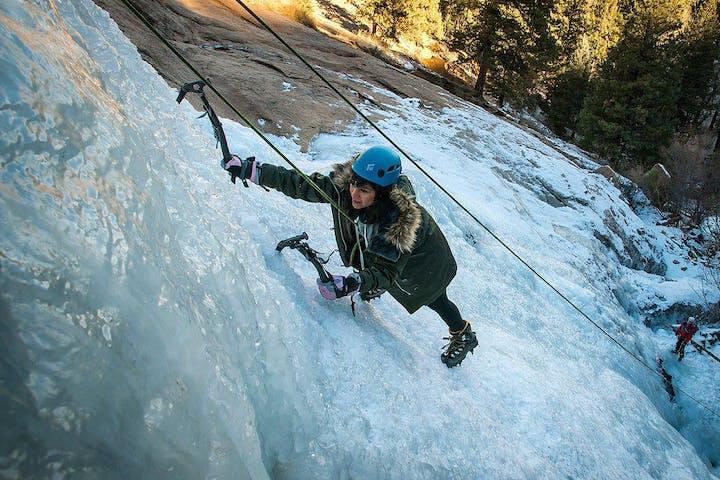 Girl ice climbing