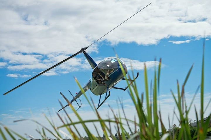 Helicopter above the green grass in New South Whales