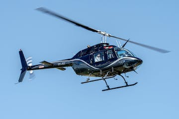 a helicopter flying in the air