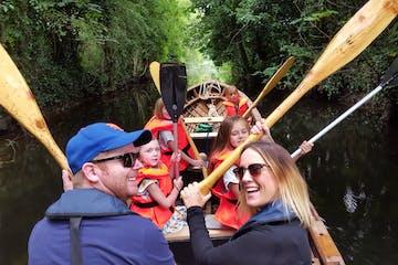 Boyne Boats tour, happy people waving with oars