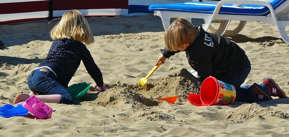 Children Sharing on Beach
