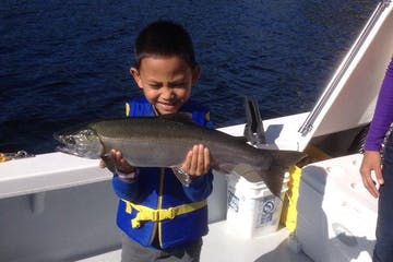 Boy with a fish he caught on a Ketchikan Charter Boat.