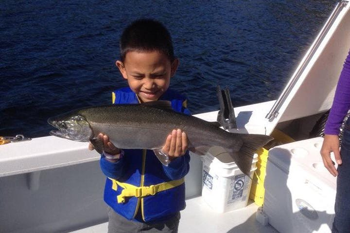 Boy with a fish he caught on a Ketchikan Charter Boat