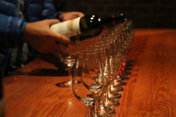row of wine glasses being filled