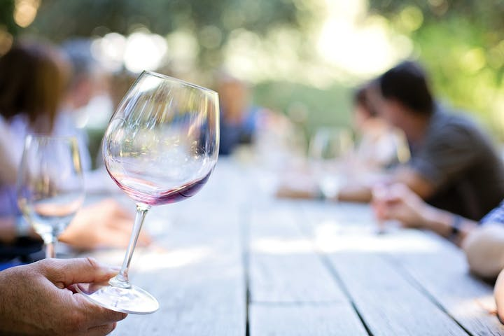 glass of wine against picnic table