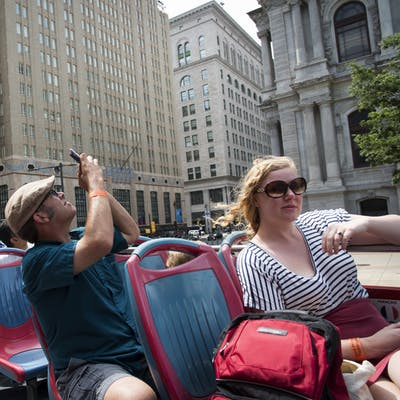 Philadelphia Sightseeing Tours passengers taking pictures of the city on the tour
