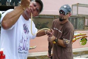 Captain Bob feeds a snake