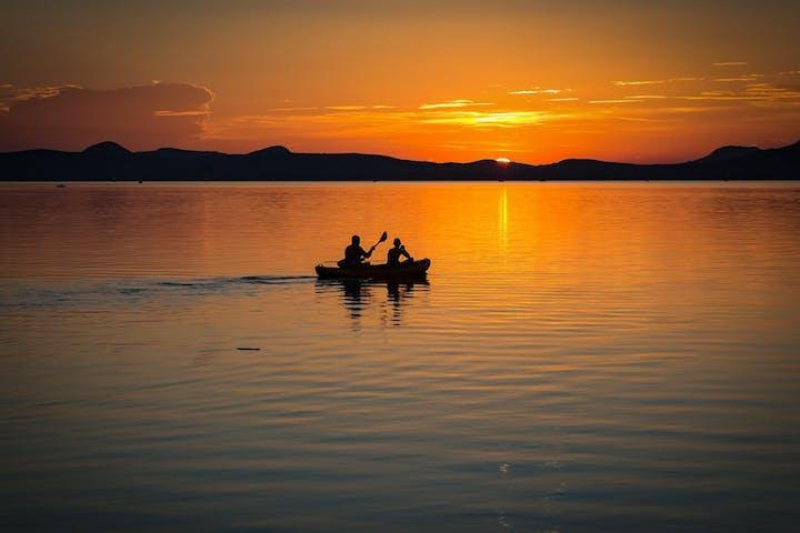 canoeing on lake balaton sunset