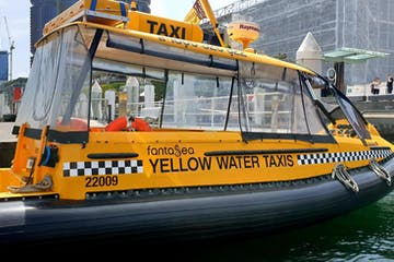 a black and yellow boat in the water