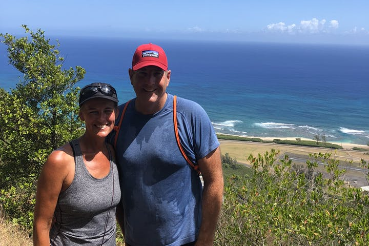 man and woman smiling on hike in oahu