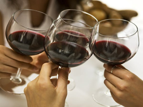 Group toasting wine glasses