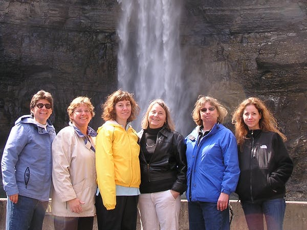 women at waterfall ithaca