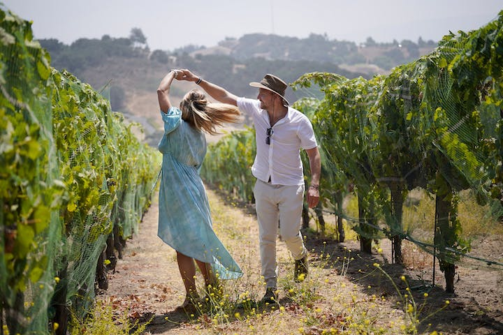 couple dancing in vineyard