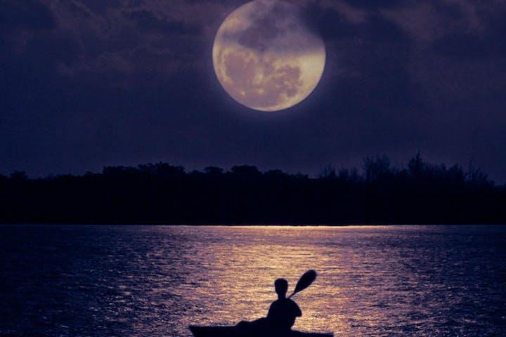 Kayaker in moonlight