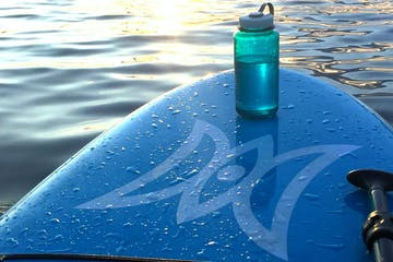 Paddle board with water bottle