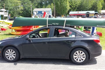car with canoe on top