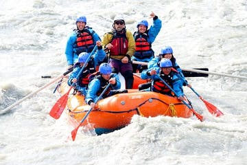 a group of people riding skis on a raft